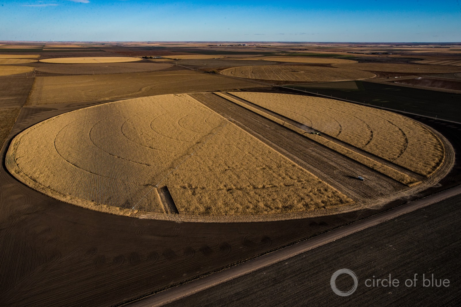 Agriculture consumes most of the world's fresh water. Here, a corn crop is harvested in the U.S. Great Plains. Photo © Brian Lehmann / Circle of Blue