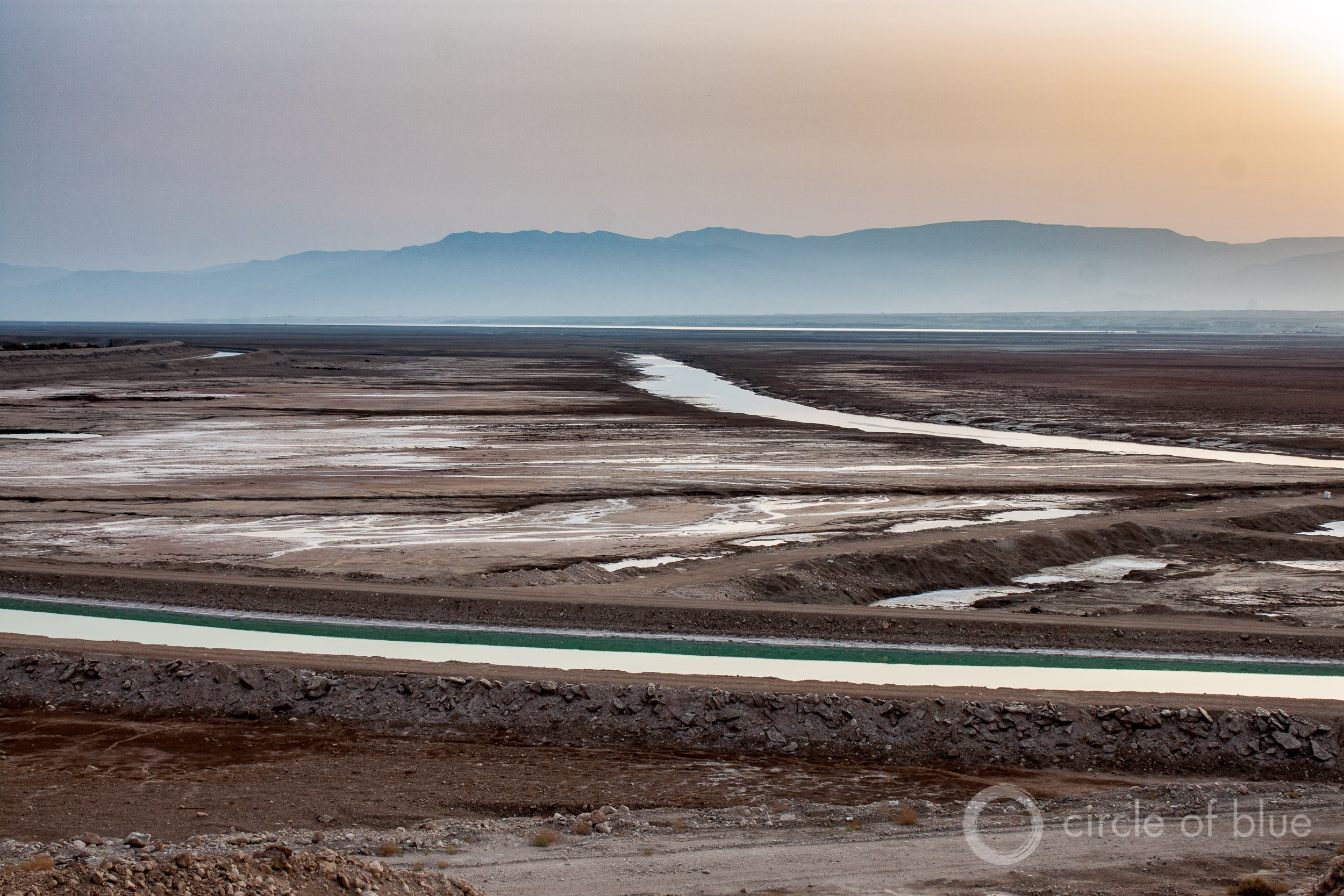 The Dead Sea, shrinking because of upstream water withdrawals, has split into two basins. The canal in the foreground moves water from the northern basin to the south. Photo © Brett Walton / Circle of Blue