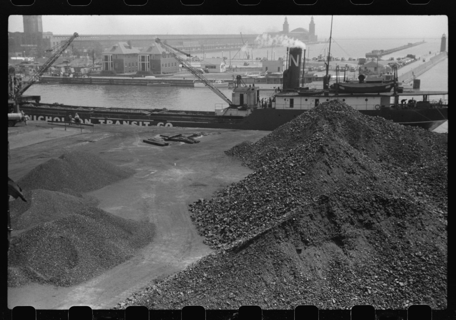A Chicago coal dock in July, 1941. Coal transported on freighters through the Great Lakes fed many of the region's power plants during the past century.  Photo Credit: John Vachon / Library of Congress, Prints & Photographs Division, FSA/OWI Collection [LC-USF33-016112-M4]